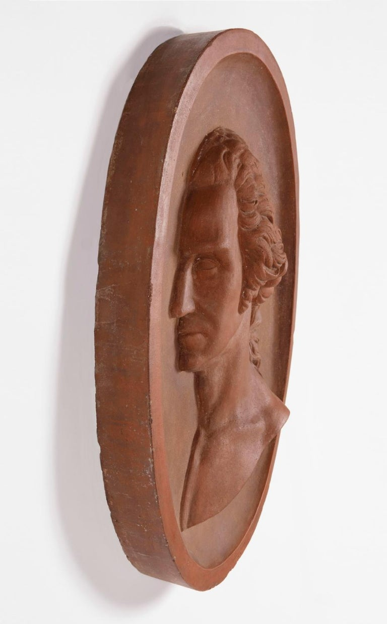 Substantial and beautiful terracotta bust of George Washington in a wall-hanging plaque, made in New York, signed and dated 1887: