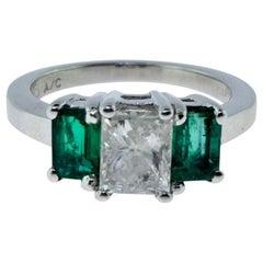Beautiful Three-Stone Dark Green Colombian Emerald and Diamond White Gold Ring