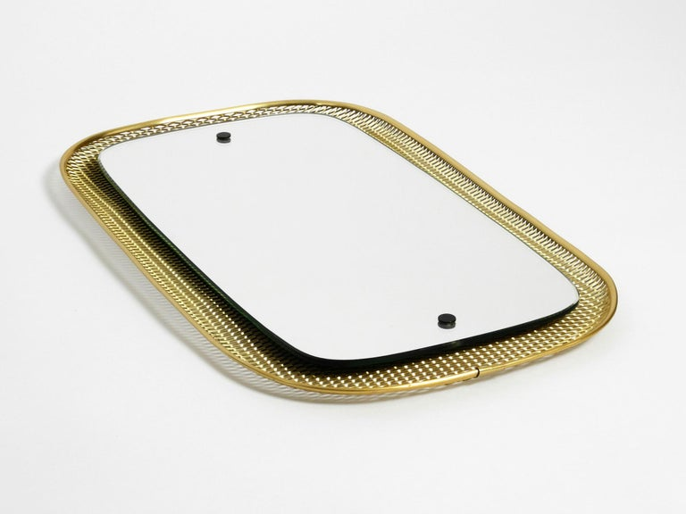 German Beautiful, Very Rare Mid-Century Modern Wall Mirror with a Brass Grid Frame