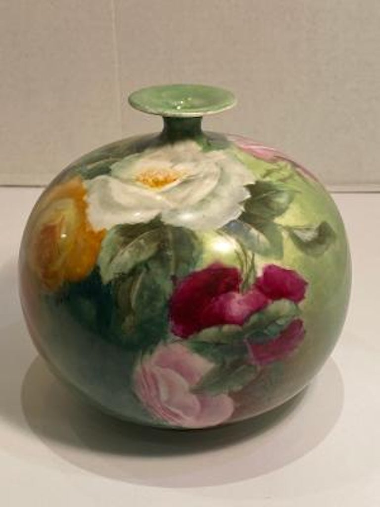 Exquisitely handmade and hand painted, turn of the century Victorian era antique porcelain vase features gorgeous, life like roses in full bloom, rosebuds and leaves, rendered in the naturalistic floral style popular in late nineteenth and early
