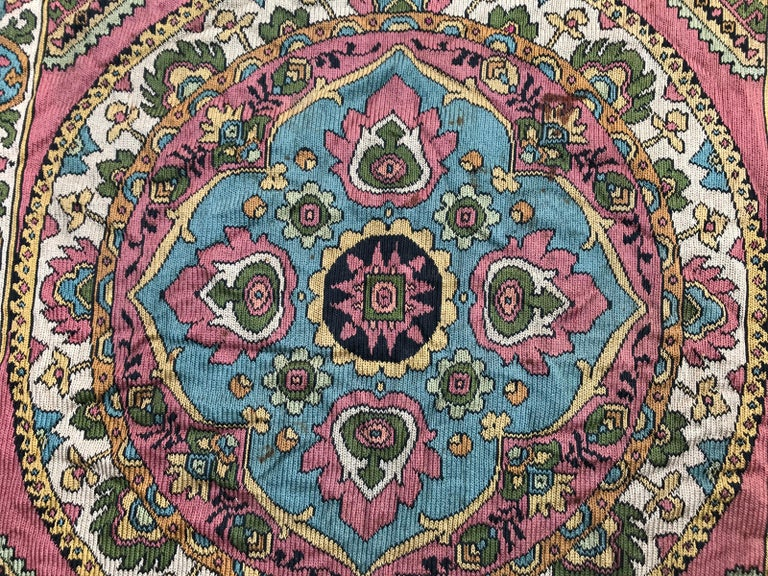 A square mid-20th century table cloth entirely hand embroidered with silk, with nice colors and Armenian design.
