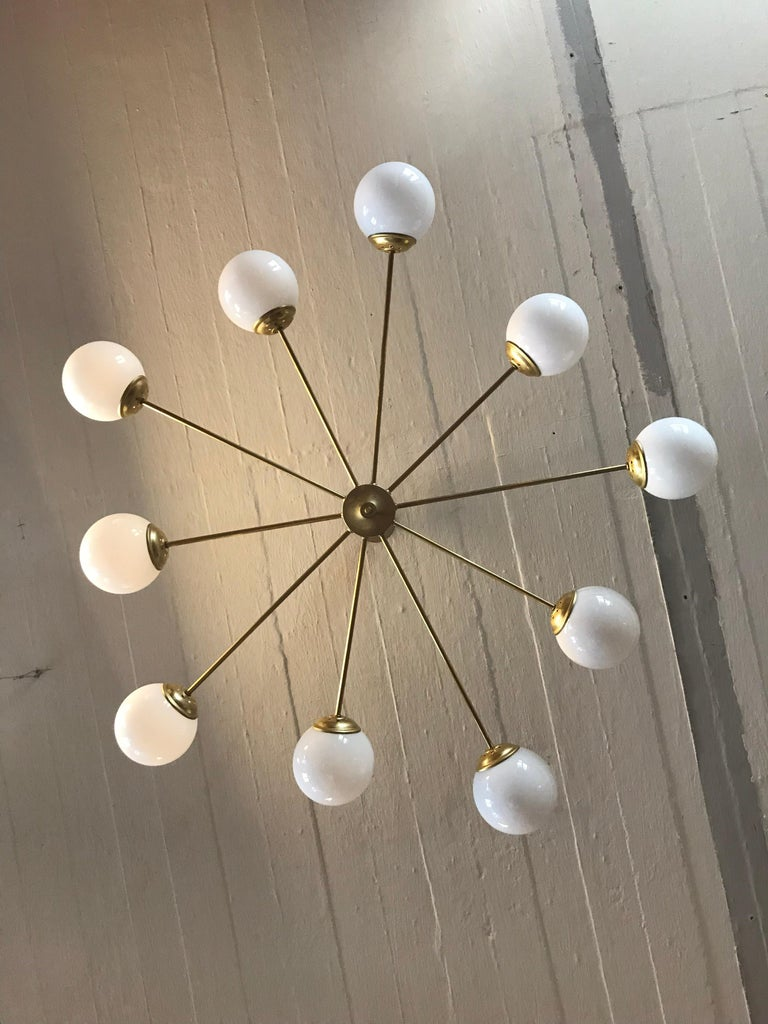 Beautiful vintage 1960s Italian 10 armed chandelier in brass and with opaline glass globe shades.  5 long 5 short arms. This gorgeous Italian chandelier has been totally refurbished with new wiring and with E15 bulb holders. A Classic design that