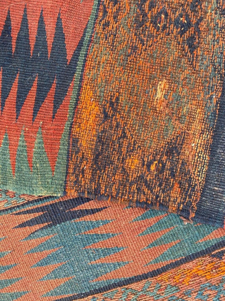 Very nice Anatolian long Kilim with a tribal design and nice colors with blue, red, green, white and orange, entirely handwoven with wool on wool foundation.