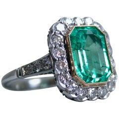 Beautiful Vintage Platinum Emerald and Diamond Halo Ring, 5.96 Carat