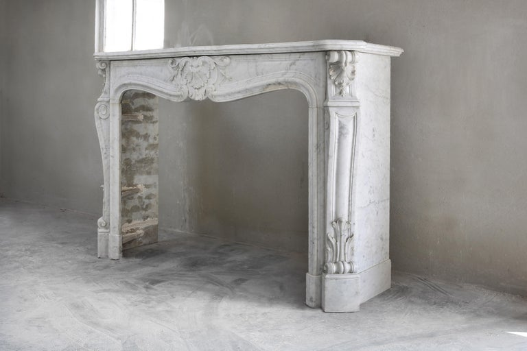 French Beautiful White Marble Antique Fireplace from Louis XV, 19th Century For Sale