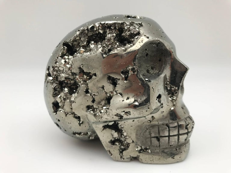 Large pyrite skull from Peru. Because of the of the shiny metallic appearance, pyrite was given the name