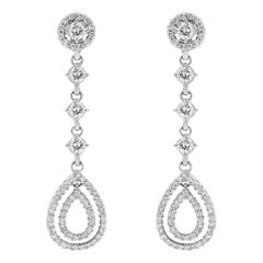Beauvince Dangling Halo Diamond Earrings in White Gold
