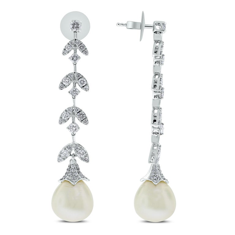 A timeless classic, the Diamond & Pearl Vines Earrings are a fine balance of elegance and flamboyance.   Gemstones Type: Pearl  Gemstone Origin: South Sea  Gemstones Shape: Drop Shape  Gemstones Weight: 33.12 ct Gemstones Color: White   Diamonds