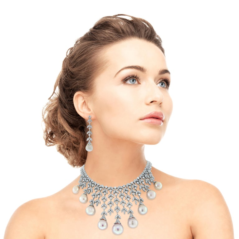 A timeless classic, the Diamond & Pearl Vines Necklace & Earrings Suite is a fine balance of elegance and flamboyance.   Gemstones Type: Pearl  Gemstone Origin: South Sea  Gemstones Shape: Drop Shape  Gemstones Weight: 136.80 ct (Necklace) & 33.12