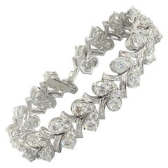 Beauvince Grapevine Round and Baguette Diamond Bracelet in White Gold