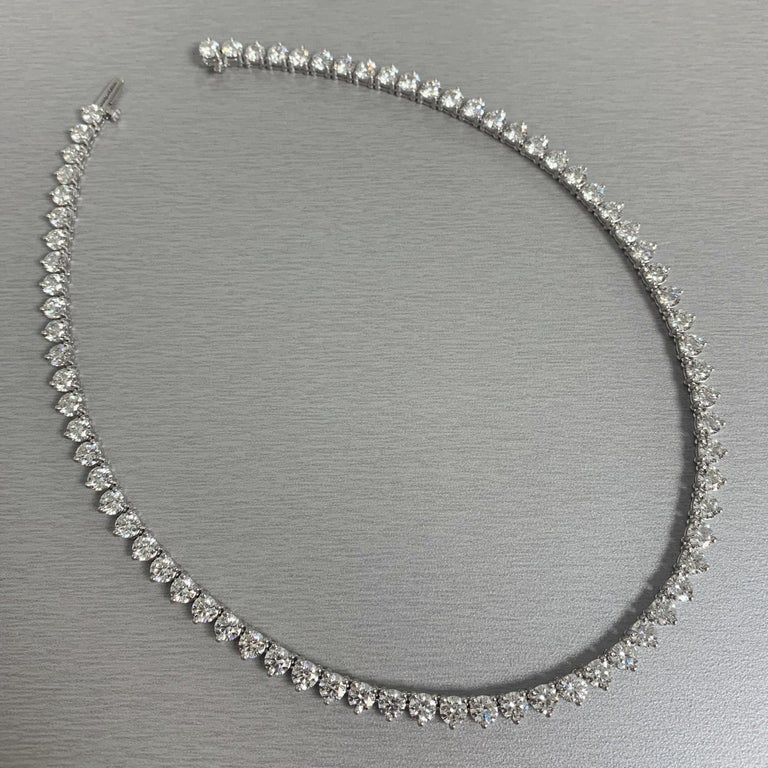 A classic and elegant everyday or occasional wear with same size diamonds all around, this Tennis Necklace is a timeless and versatile piece of jewelry. All our necklaces have two locks for added security.  This tennis necklace features a slight