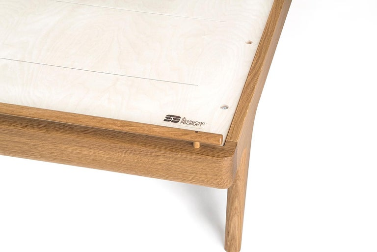 This listing is for a Queen Rian Bed in White Oak with Kraft Danish Cord. Custom options available.  A good bed is hard to find, but a Semigood bed is hard to beat. The Rian Bed features a unique two panel woven Danish cord headboard making for one