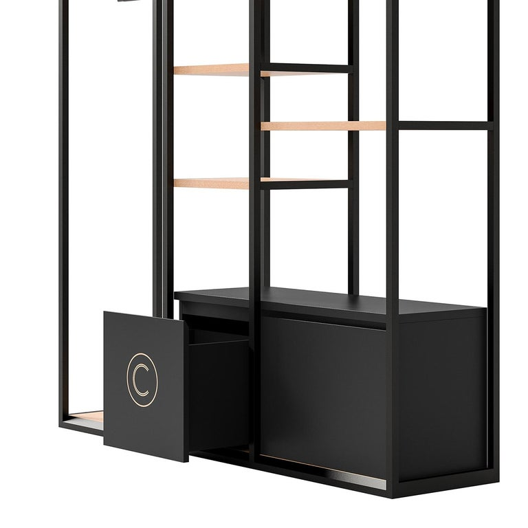 The Minimalist flair and floating appearance of this sophisticated shelving unit will add style to a modern and Minimalist bedroom. This eclectic piece is framed in black-finished metal with light veneered shelves and comprises three sections, each