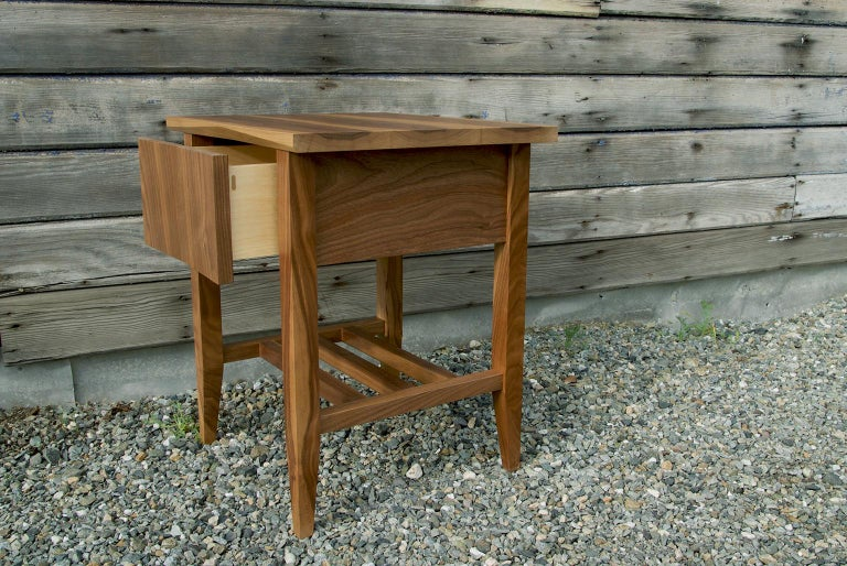Modern, hardwood rift end table, nightstand storage bedside table. The bedside table features timeless lines, subtle tapers, a soft close drawer and a wooden under carriage for storage.