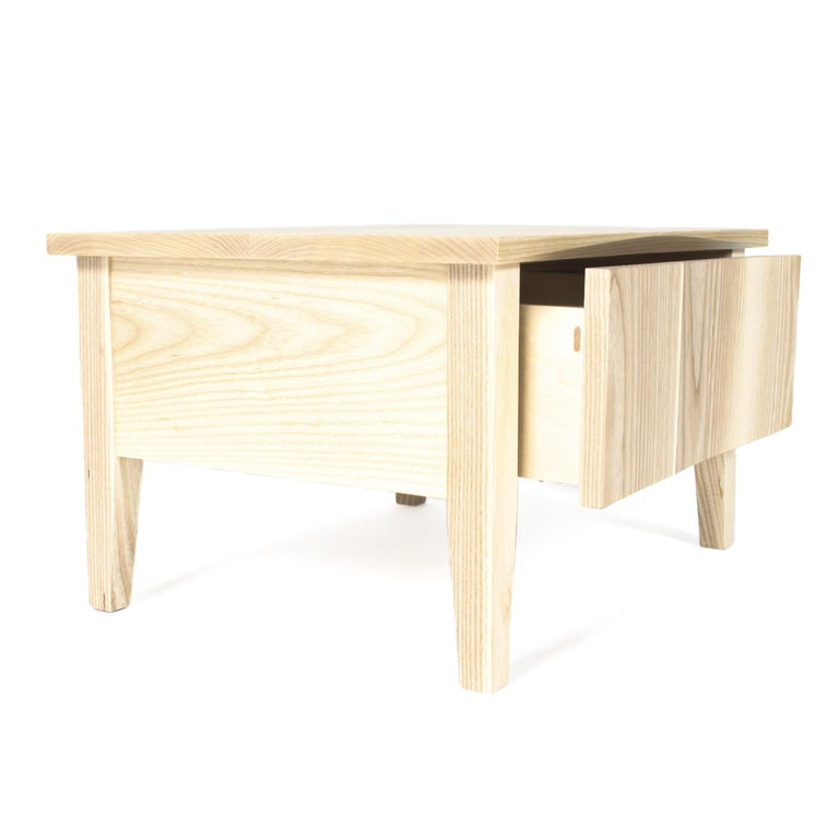 Hardwood bedside table in white ash boasting the subtle lines and angles that define the Rift Collection. Soft close drawer.