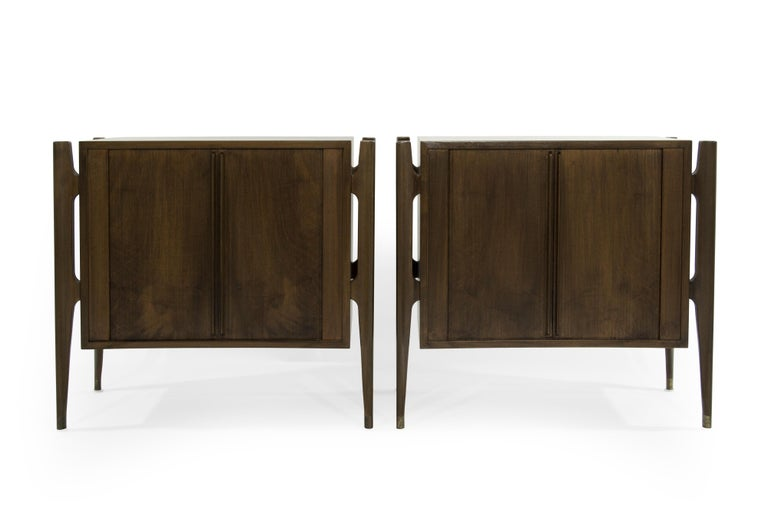 Extremely rare set of rosewood bedside tables designed by Jorgen Clausen for Brande Møbelfabrik in fully restored condition.  Often misattributed to Edmond Spence. This particular set features bookmatched tambour doors, exterior framing and brass