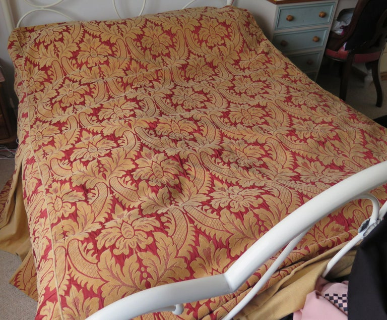 This is a double bed size bedspread or bed throw, with box side pleats in a Baroque style red and gold pattern, which we date to the second half of the 20th century.  The bed spread is large and made of a woven Chenille type outer fabric with a
