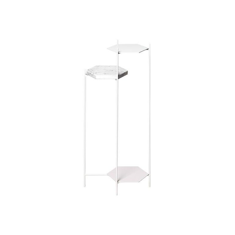 The Bee minimalist side table is a set of hexagonal structures of ethereal character that pretend to be inhabitated by multiple objects, creating a Scope where each of them coexist and relate laying in three plans suspended at different heights.