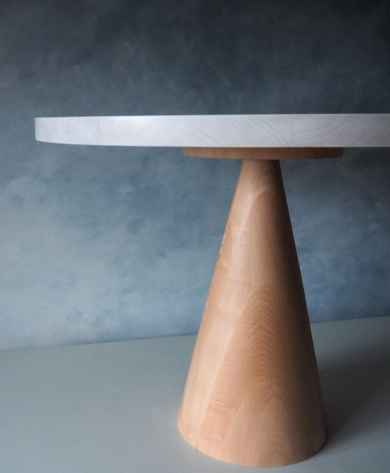 Our comet dining table is the perfect centrepiece for your space. With a whitewashed beech table top and solid maple base this piece is stunning in a wide range of decors. The base has been carefully turned in our studio and hand waxed to insure a
