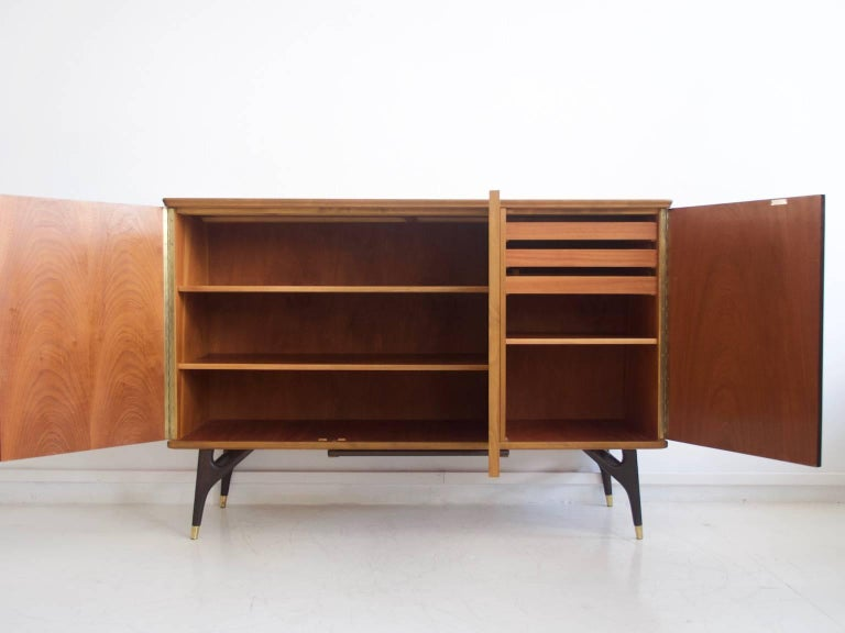 Sideboard veneered with partly stained beech and teak from circa 1950-1960. Manufactured by Tabergs Mobler. Legs with brass braces. Three doors, interior drawers and shelves. Key included. Very good condition, minor marks as seen on photos.