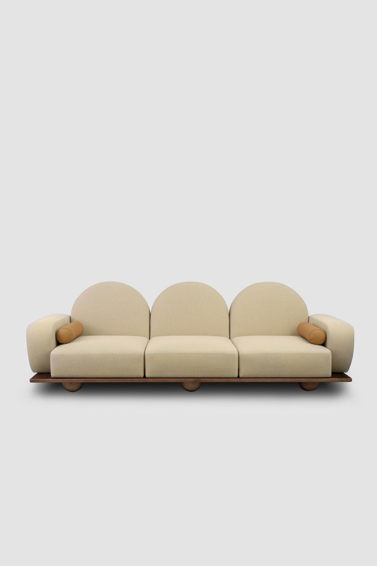 Beice is a 3-seat sofa designed to mimic the feeling of sitting on cotton candy clouds. The combination of its powder pink color, arc shaped back rests, round edges and sphere walnut feet creates a dreamy, tender design. It is wide enough to lay