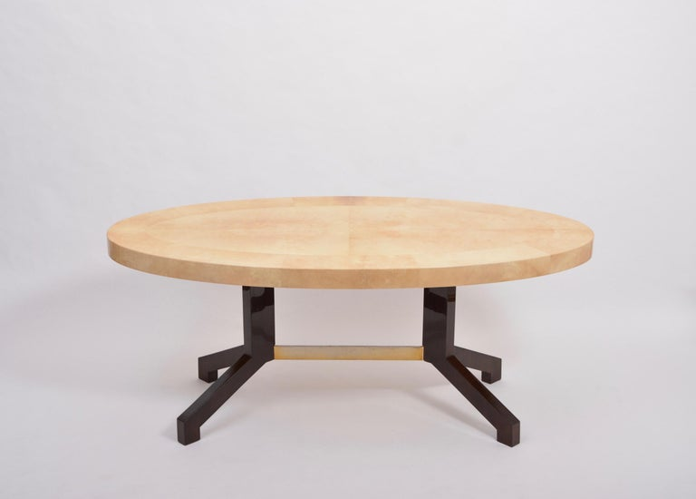 Oval dining table designed by Aldo Tura and produced in Italy in the 1970s. This dining table is a very strong example of his work, simple in form, with a soft curved oval top affixed to two mahogany feet connected with a metal bar. The ethereal