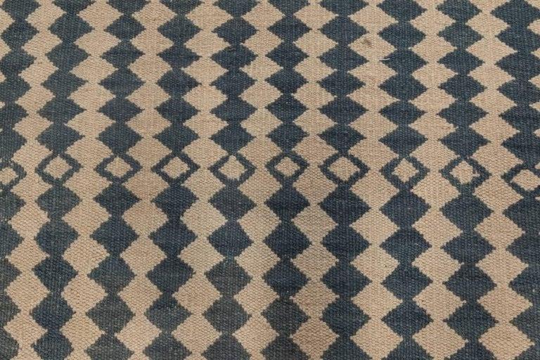Beige and dark blue modern flat-weave rug Size: 8'10