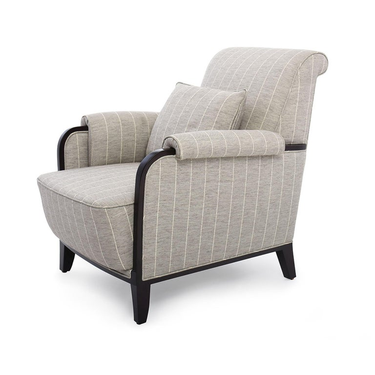 The Bel Air lounge chair I is a rich, timeless piece. With a wood frame, and scroll back detail, this chair is fully upholstered on all sides. Features a down wrapped foam cushion and seat back. Due to the handcrafted nature, each piece may have