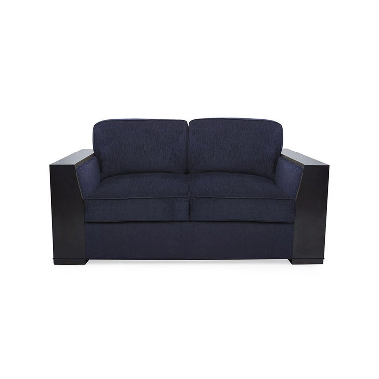A rich and generous seat, the contemporary Bel Air Loveseat makes a solemn and substantial contribution to any room in which it sits. With a sleek wood frame, this chair is fully upholstered on all sides, and is luxuriously deep. The down wrapped