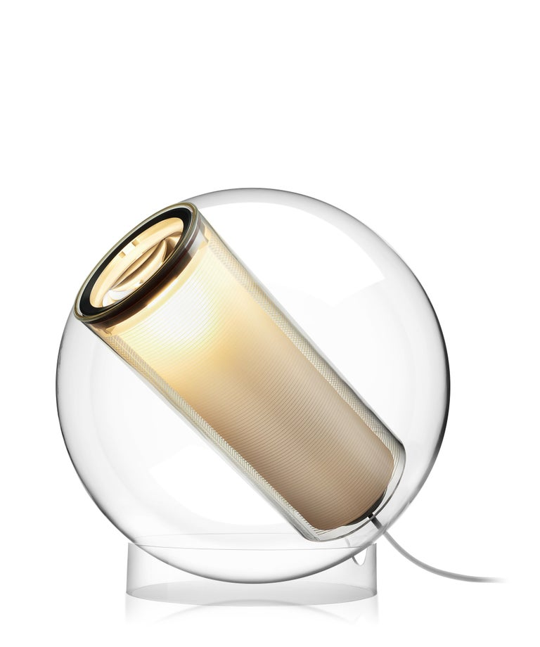 Bel Occhio is both a multi-position spot light and ambient table lamp combined. The spherical acrylic shell is gently cradled in its base allowing infinite adjustment with a touch of the hand. Bel Occhio is also available in pendant