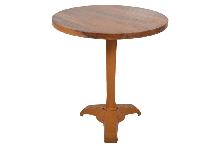 Wonderful ochre painted Art Deco cast iron bistro table base with well figured walnut top. Tripod leg with fan shaped decorations.