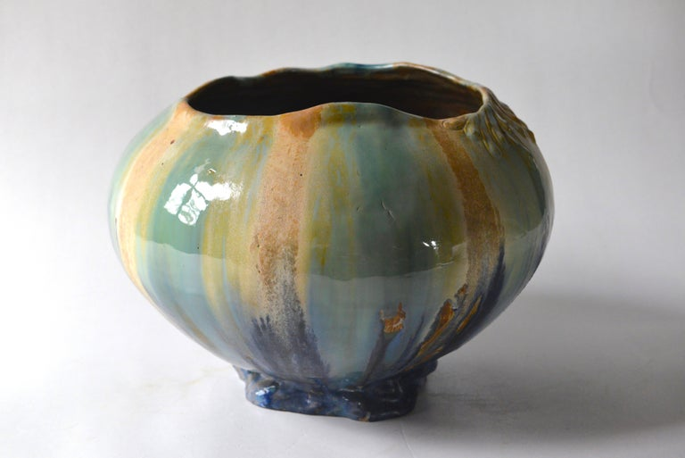 Beautifully glazed Art Nouveau vase in naturalist shape with some delicate vegetal decorations around the undulating opening. The colors are amazing, ochre, deep blue, mint and turquoise.