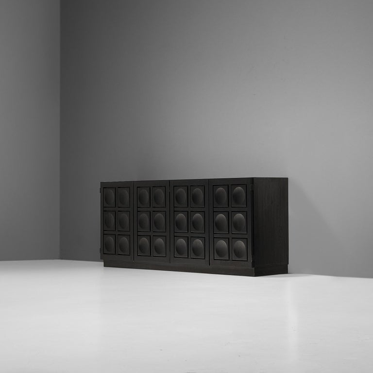 Belgian sideboard, black colored wood, metal, Belgium, 1980s  This grand Belgian sideboard is a real eye-catcher. The sideboard features graphical designed doors that add a wonderful rhythmic and haptic surface to the front. The three-dimensional