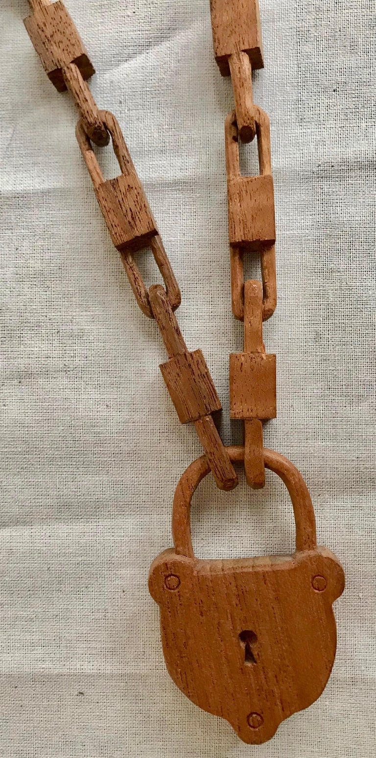 Belgian carved wood chain with lock, circa 1940. A charming piece of Folk Art to display or wear as a necklace.