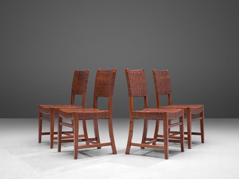 Frits Schuitema for Shaker Furniture by Schuitema en Zonen, set of six dining chairs model 1130, oak, leather, Belgium, 1970s  A beautiful set of midcentury dining chairs by Belgium designer and furniture maker Frits Schuitema with woven leather