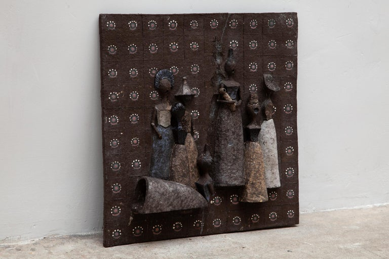 Vintage ceramic wall art. Brown earthenware with hand painted accents. Design of 8 figures in ceramic and glazed in the tones blue, gold, white and grey.