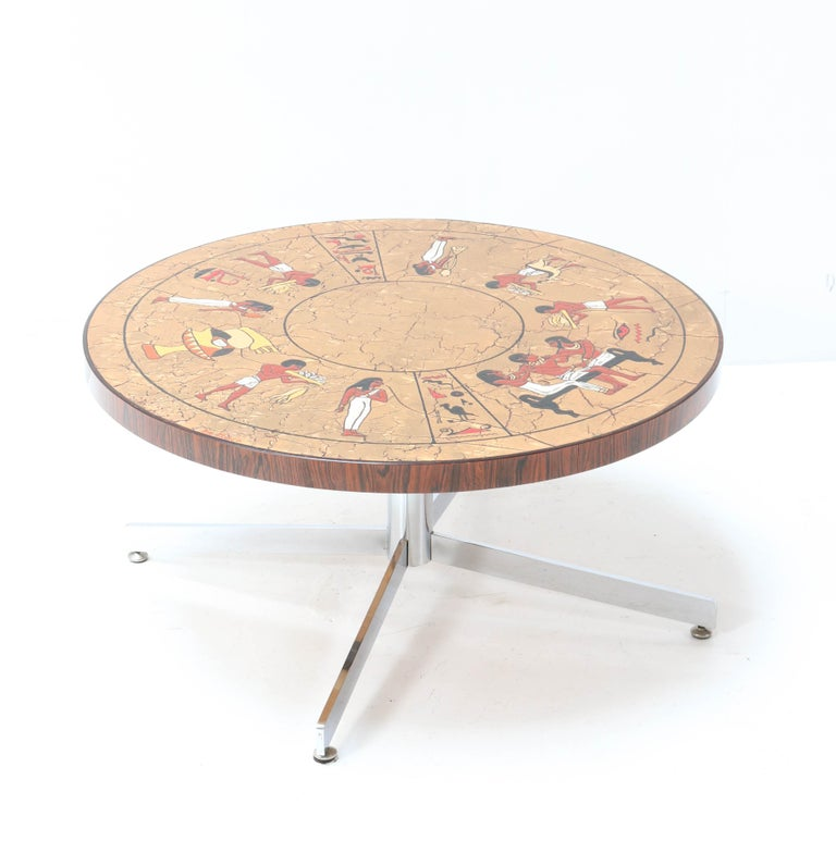 Elegant and rare Mid-Century Modern coffee table. Design by Denisco. Striking Belgium design from the 1960s. Chrome-plated base with original top with tiles in Egyptian style. Marked with manufacturers mark on top of the table. In good original