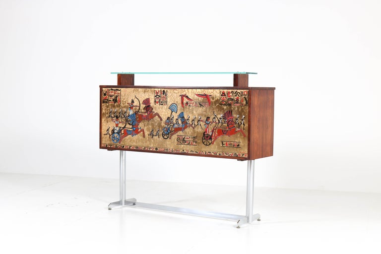 Magnificent and very rare Mid-Century Modern dry bar. Design by Denisco with manufacturers mark in the tiles. Striking Belgium design from the 1960s. The bar cabinet is made of rosewood veneer and tiles in Egyptian style with glass sliding doors