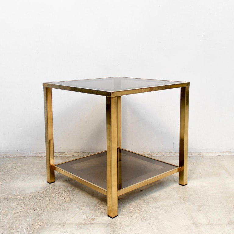 23-karat gold-plated side table with shelf circa 1980s Belgian. Finished in an attractive and elegant soft gold tone this table is an alternative choice to yellow gold or chrome. The minimal form and warm metallic tones make this table suitable for