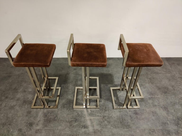 Beautiful original chrome and suede bar stools by Belgochrom.  Beautiful timeless design with a luxury appeal.  They have their original brown suede upholstery which mixes well with the chrome frame.  The chrome has been polished, although it