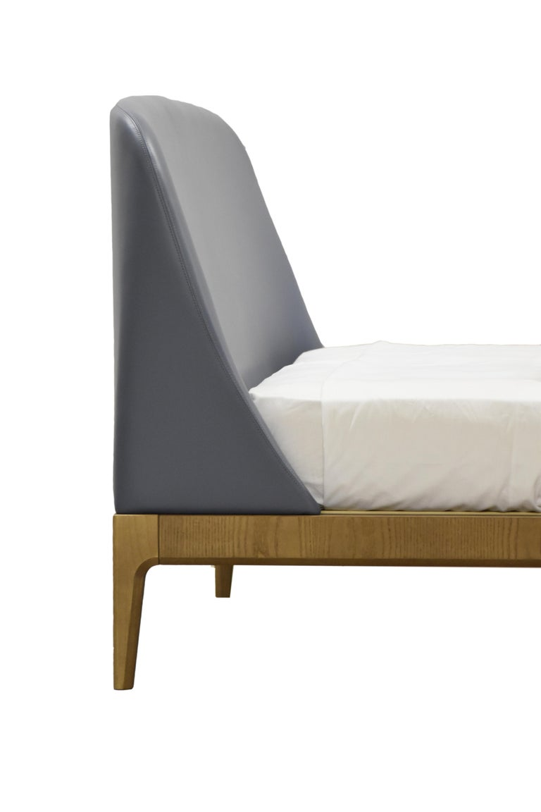 Bellagio Contemporary bed made of ashwood with leather or fabric upholstered headboard. Available in different sizes. Designed by Libero Rutilo