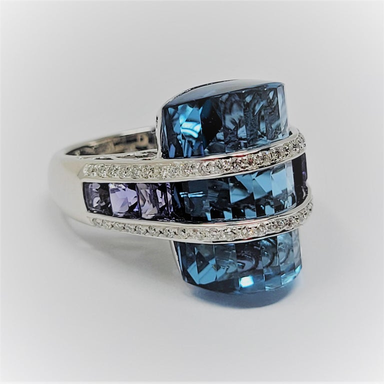 Bellari blue topaz accented with iolite and diamonds in 18 karat white gold.  This ring is sure to please!