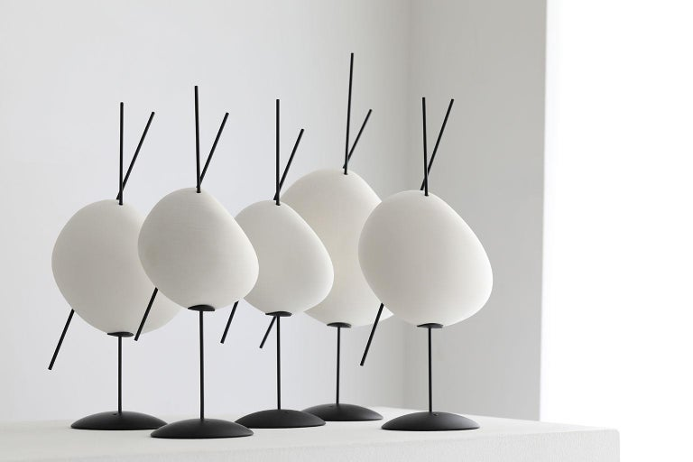 """A sculpture by day and a light sculpture by night, """"Belle de Nuit"""" combines the delicacy of the thin metal bars and bisque volumes with the practical and modern lighting technology of a battery powered lamp.   The choice of materials was crucial"""