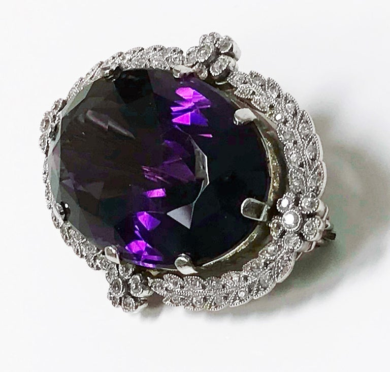 Antique Platinum Amethyst Diamond Brooch Pendant, English C.1910. The large Brooch Pendant set with a very fine oval medium-dark violet purple Amethyst, gauging approximately 33 x 20 x 12 mm, approximately 47.56 cts. The platinum milligrain and