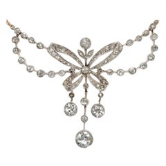 Belle Époque circa 1905, 2.49 Carat Diamond Platinum Garland Style Bow Necklace