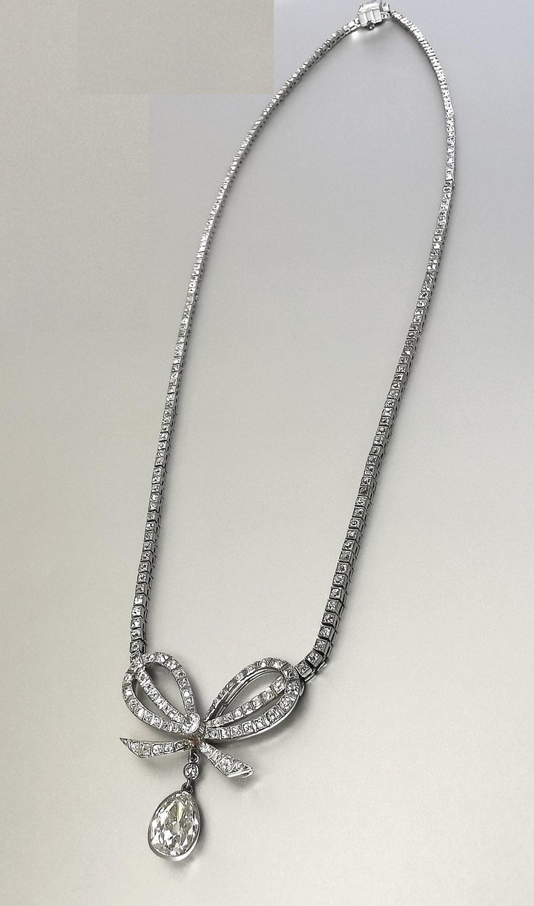 Belle Époque Diamond Platinum Bow Pendant Necklace For Sale 1