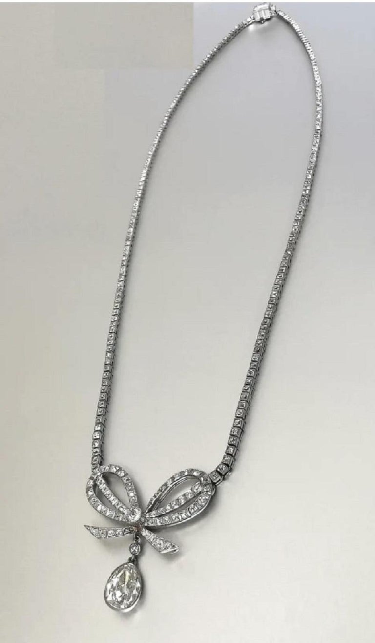 Belle Époque Diamond Platinum Bow Pendant Necklace For Sale