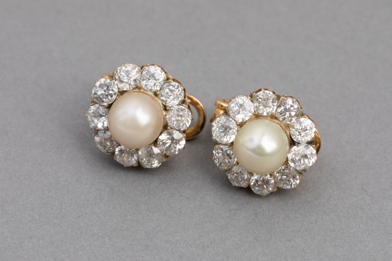 Beautiful Pair of clip earrings, made in France circa 1910, Belle Epoque Era.  The earrings are set with Very beautiful old mine diamonds and two cultural Pearls.  the diamonds weights 2 carats approximately for the total, they are very good
