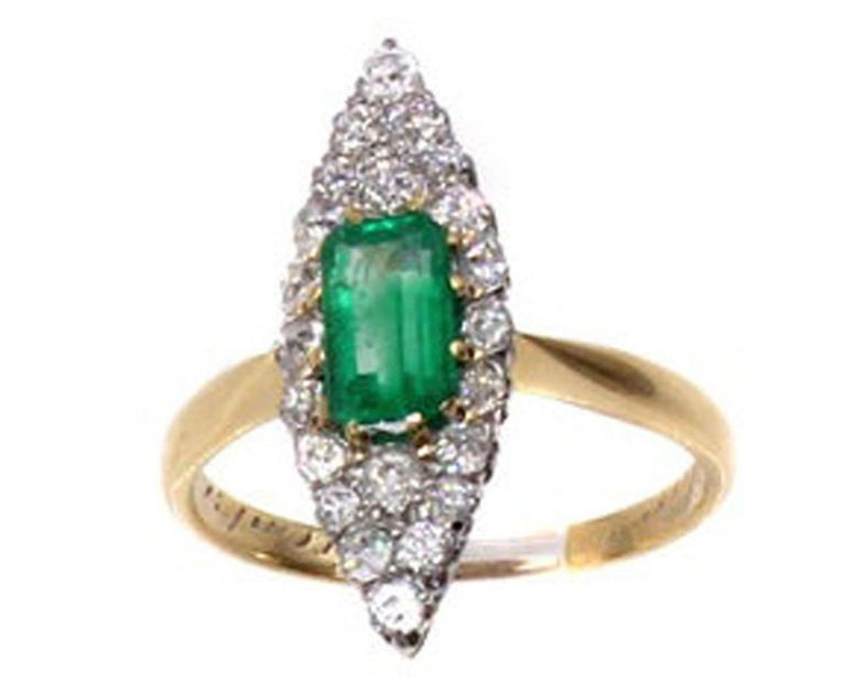 Beautifully designed and masterfully hand-crafted in 18 karat gold, this charming Victorian ring from ca 1870 displays a wonderful contrast of colors. From the forest green elongated step-cut emerald to the bright white perfectly matched Old