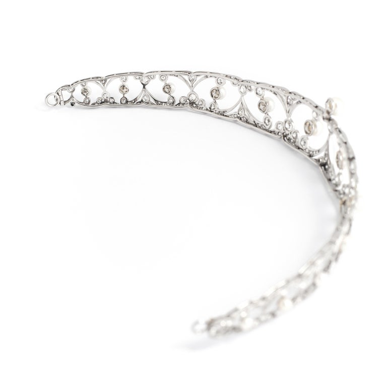 Belle Epoque Tiara diamond and pearl. Total 14.00 carats on platinum and white gold.  Length: 7.48 inches (19.00 centimeters) Width: 5.41 inches (14.00 centimeters) Height: 0.87 inch (2.20 centimeters at the highest)